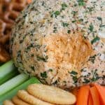 Buffalo Chicken Cheese Ball with a portion missing.