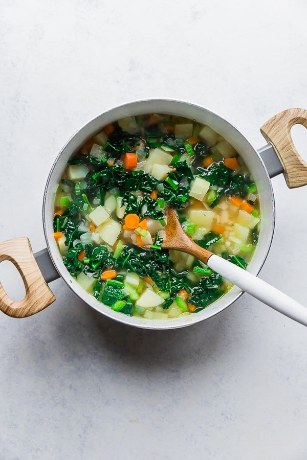 Vegetables and broth for One Pot Bacon and Tortellini Zuppa Toscana.