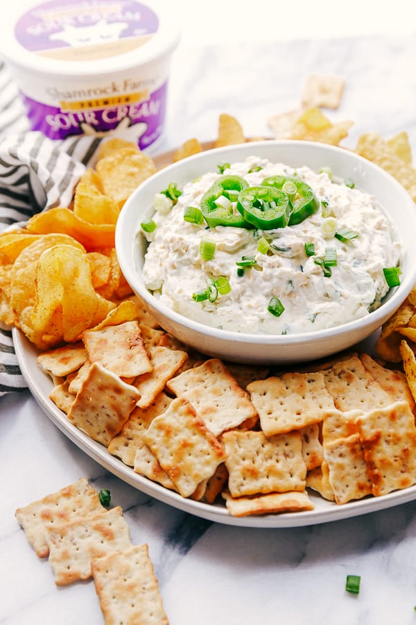 A plate filled with crackers, Chips, Jalapeño Ranch Dip made with Shamrock Farms Sour Cream.