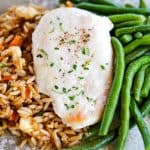 A balanced meal with Schwan's Vegetable Fried Rice, Chicken Breast Fillet and MicroSteam Whole Green Beans plated.