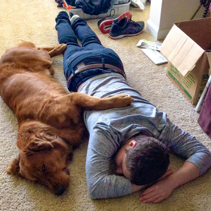 Logan the Golden Dog - Mother's Day asleep on the floor with our son.