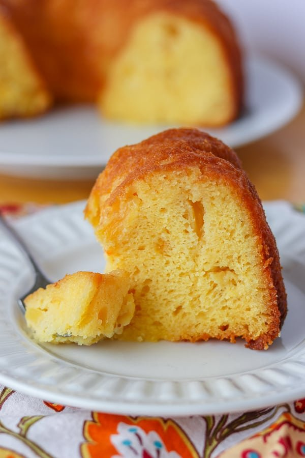 A bite of Pineapple Rum Cake on a fork.
