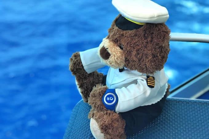 Stanley at sea wearing the Princess Ocean Medallion.