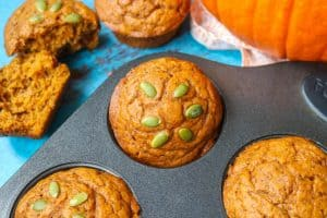 A Dairy-Free Pumpkin Muffin in a baking tin.