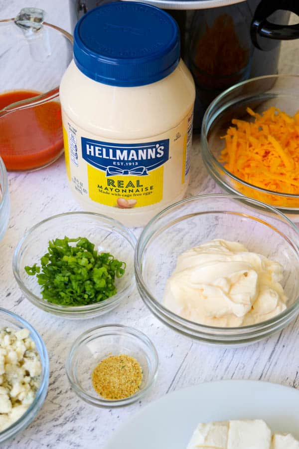 Hellmann's Mayonnaise and the ingredients for the Slow Cooker Buffalo Chicken Dip.