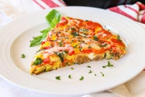 Slice of Meat Lover's Pizza Frittata on a plate.