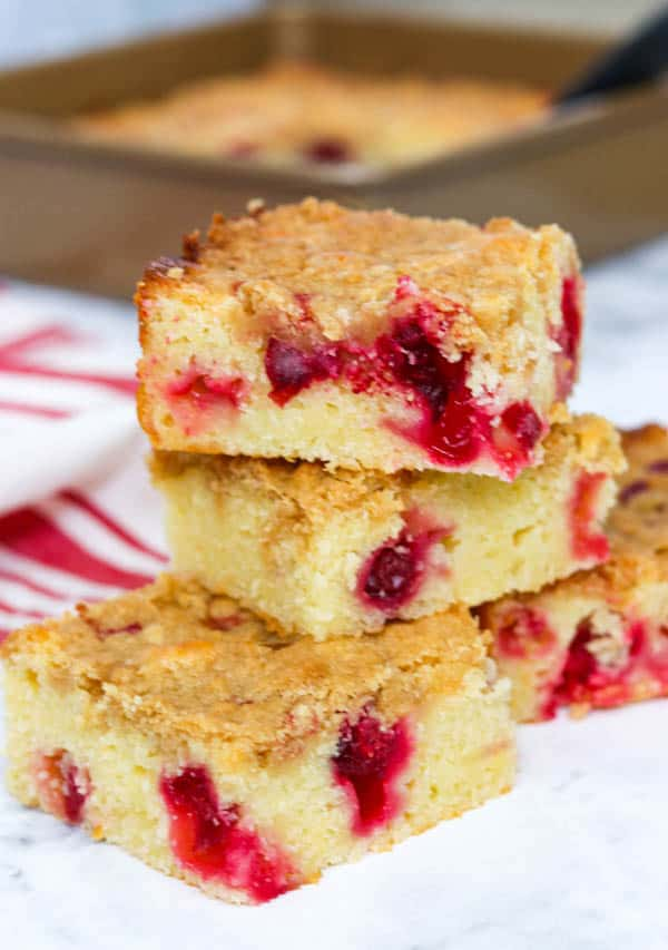 Stacked slices of Cranberry Coffee Cake.