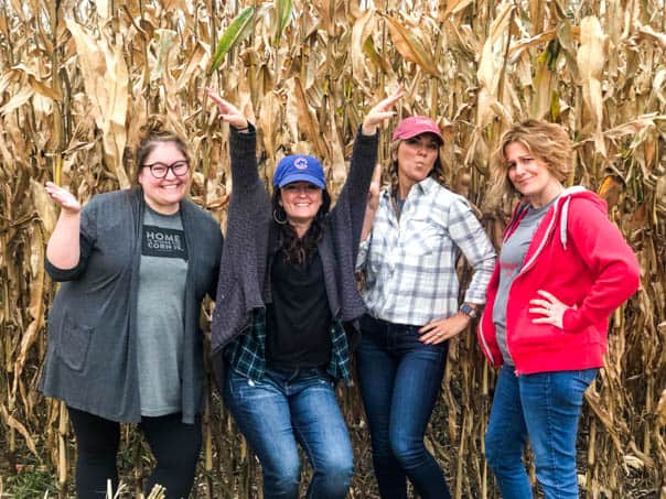 Bloggers being corn-y in an Iowa cornfield.