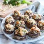 Cheesy Sausage Stuffed Mushrooms on a plate.