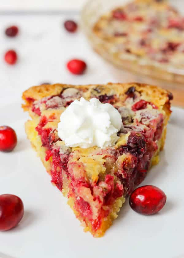 A slice of Easy Cranberry Pie Recipe topped with whipped cream.
