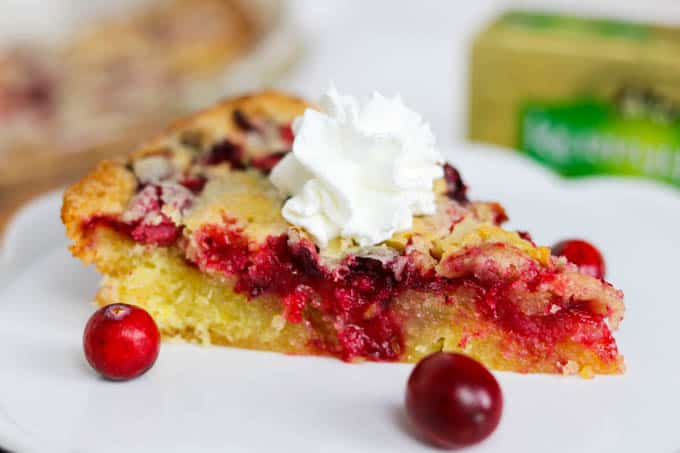 A slice of Easy Cranberry Pie Recipe topped with whipped cream and cranberries.