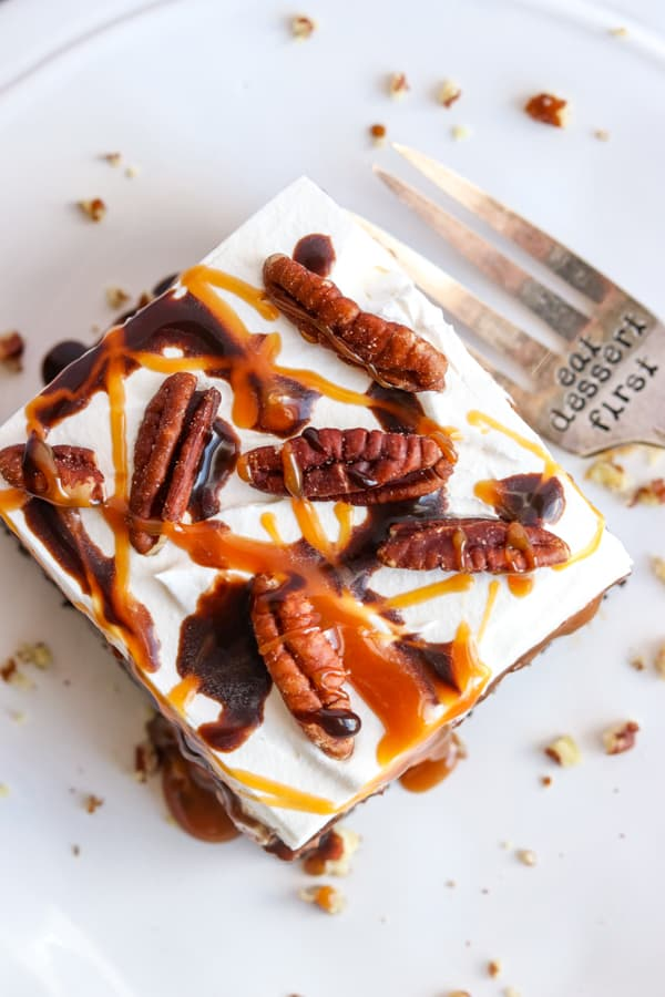 Caramel, chocolate and pecans on top of No Bake Turtle Dream Bars.