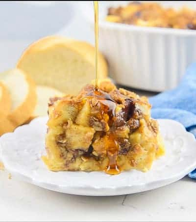 Syrup drizzled on Peanut Butter and Jelly French Toast Casserole.