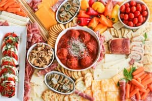An assortment of meats, cheeses, crackers, nuts, veggies, meatballs and more perfect for snacking, entertaining and dinner!
