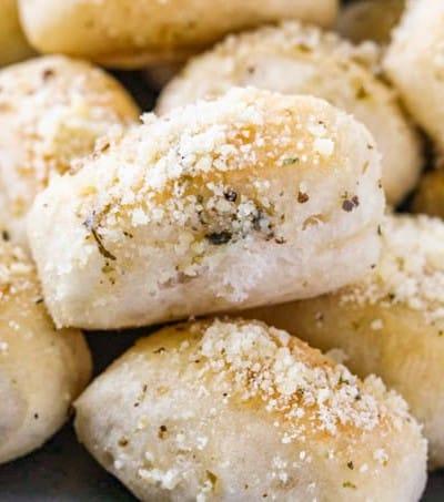 A bunch of bake bite size bread dough.