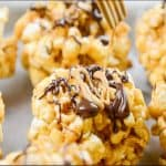 Drizzling PB2 Organic Powdered Peanut Butter on a popcorn ball.