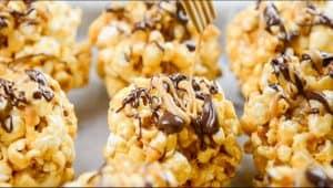 Drizzling PB2 Organic Powdered Peanut Butter on a popcorn ball.