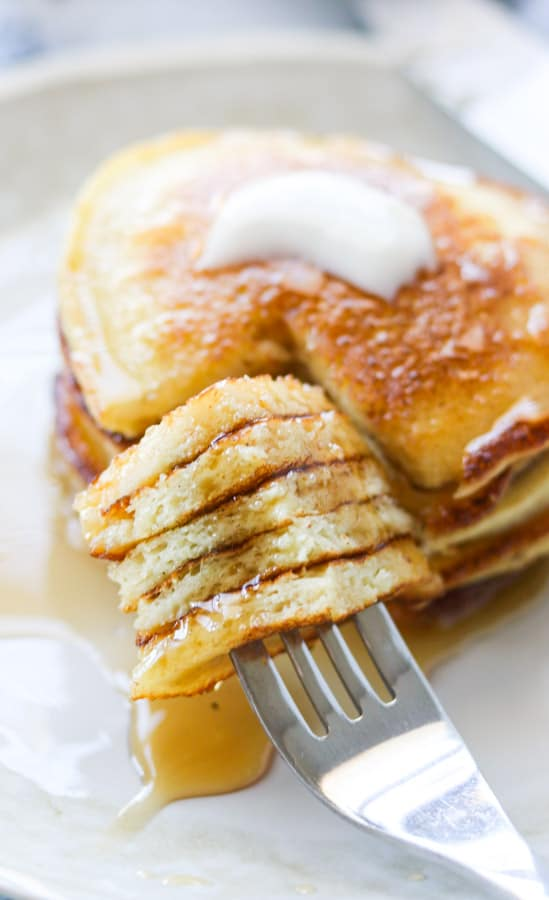 A bite of griddle cakes on a fork.