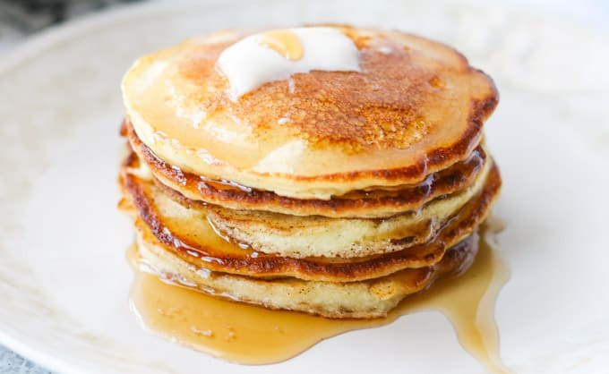 Syrup dripping off a stack of pancakes.