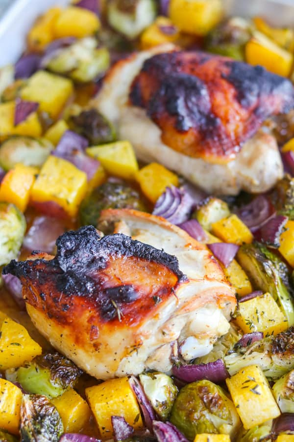 Cooked chicken thighs and vegetables.