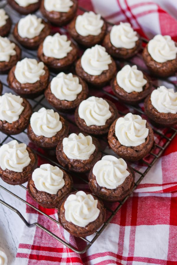 Small brownies with frosting.