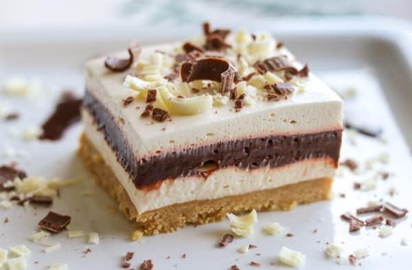 Layers of cookie crust, Irish cream cheesecake, chocolate pudding and whipped cream.
