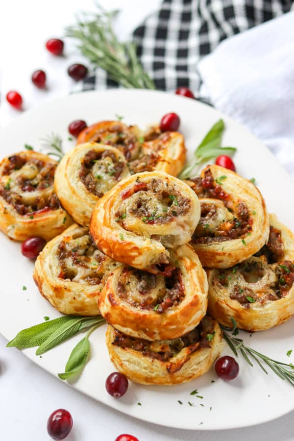 Sausage, Cranberry, Brie Bites on a plate ready to be served.