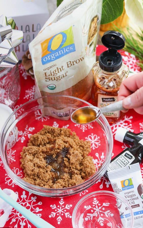 Adding honey to a brown sugar exfoliator.