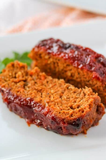 Two slices of meatloaf on a plate.