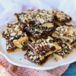 Toffee covered in chocolate and almonds.