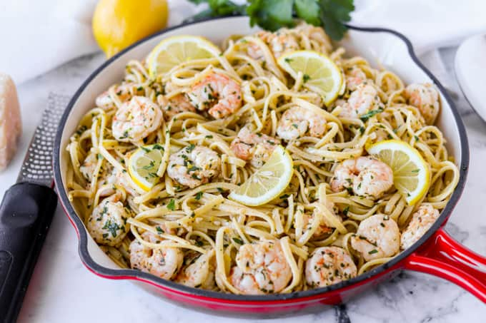 A pan of pasta with shrimp.