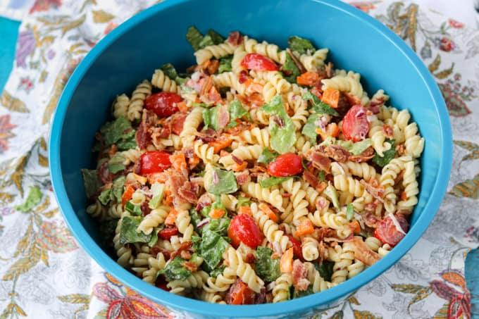 A bowl full of pasta salad.