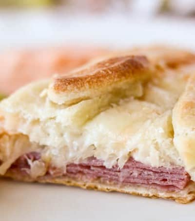 Layers of corned beef, Swiss cheese, sauerkraut, and Marie's Thousand Island Dressing.