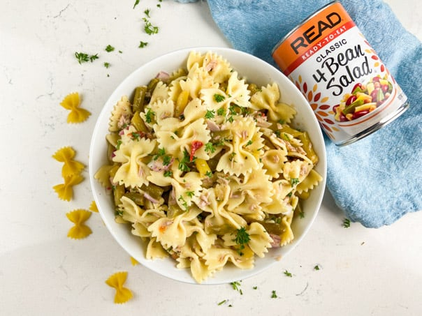 Easy pasta salad made with 4-bean salad, pasta, tuna, red onion, and parsley.
