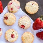 An tray of scones made with strawberries, cream cheese and lemon zest.