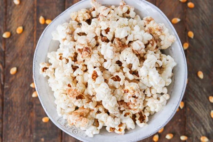 A bowl of popcorn with cinnamon sugar.
