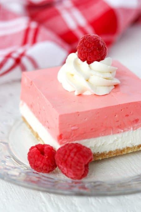 Sweet delicious layers in a creamy raspberry no bake jello dessert.