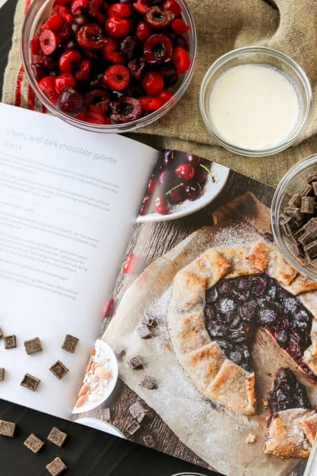 Making a galette with cherries and dark chocolate.