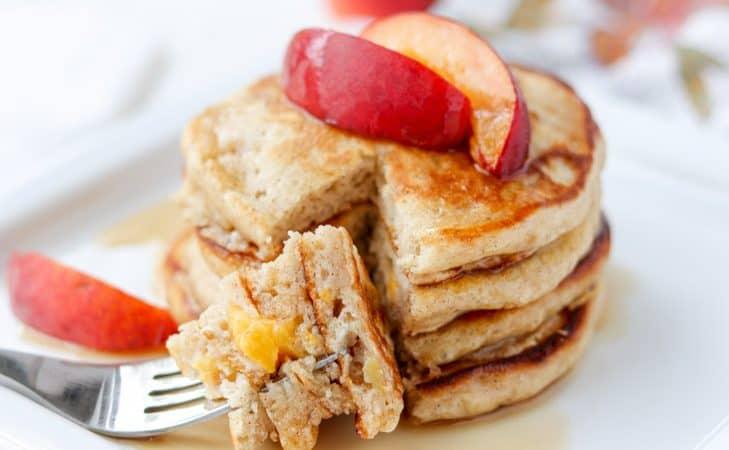 A bite of Cinnamon Peach Pancakes.
