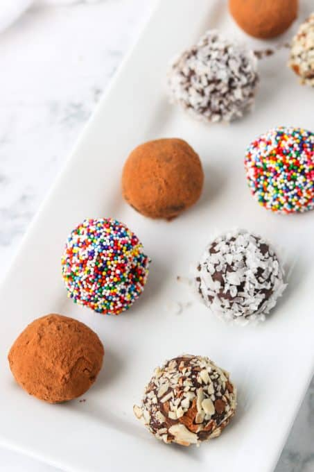 Small balls of chocolate ganache covered in a variety of coatings.