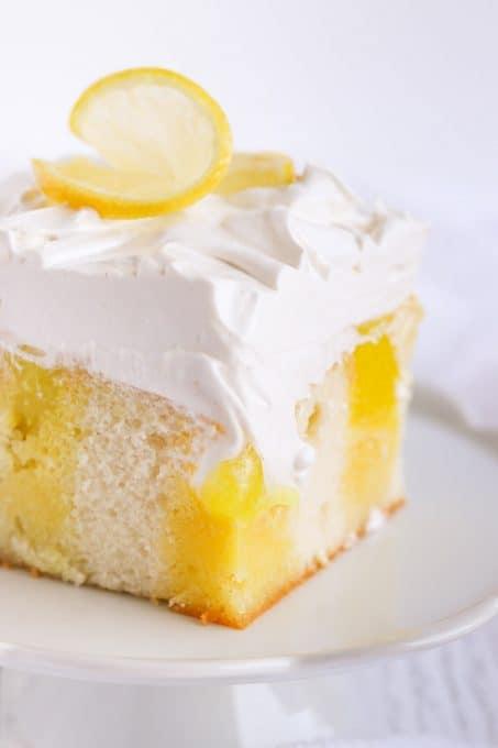 Lemon Poke Cake with lemon gelatin, lemon pie filling and marshmallow frosting.