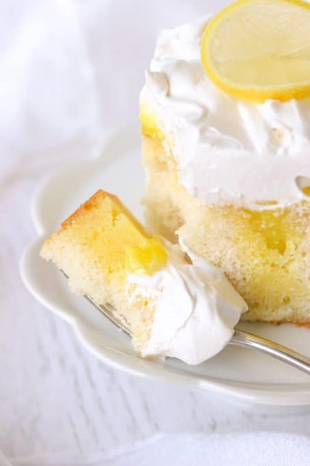 A bite of Lemon Marshmallow Poke Cake.