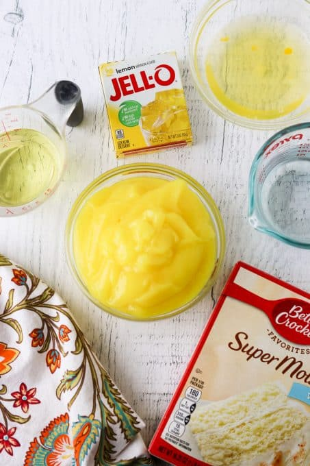 Ingredients for a lemon poke cake with marshmallow frosting.