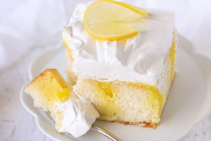 White cake with lemon gelatin, lemon pie filling and marshmallow frosting.