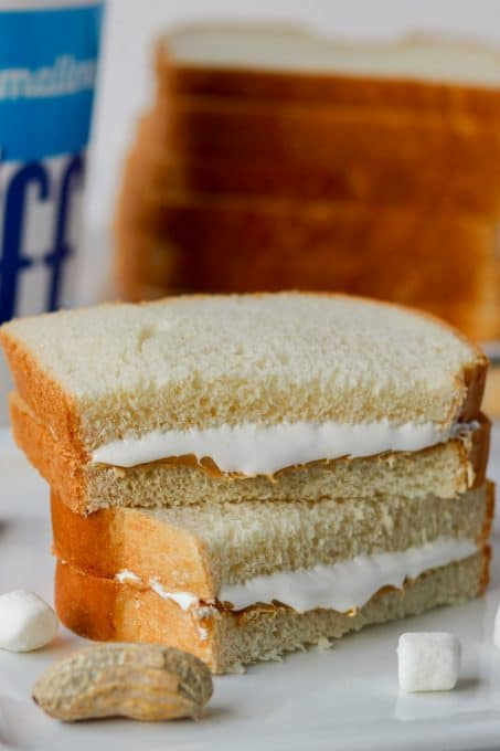 A sandwich made of peanut butter, marshmallow fluff and bread.