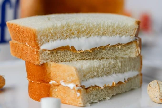 A peanut butter sandwich with marshmallow fluff.