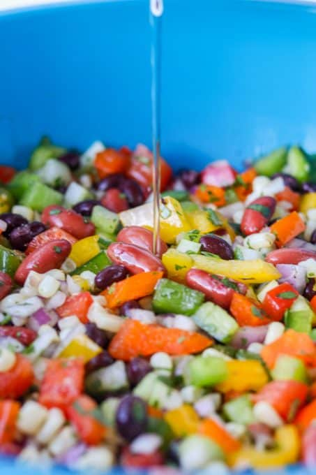 Pouring the marinade over the ingredients for Texas Caviar.