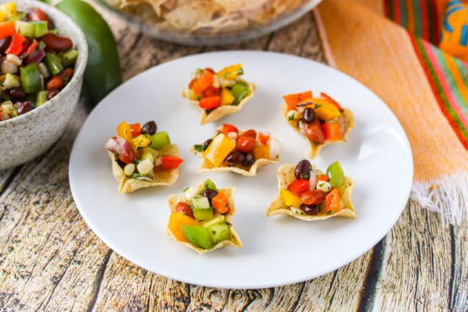 A plate full of tortilla scoops filled with an easy and delicious appetizer.